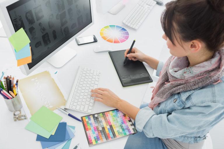 woman making digital art using her computer